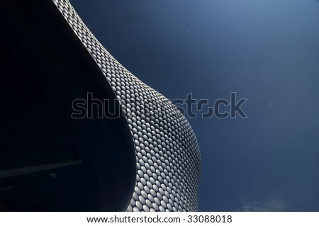 Modern abstract background.  Image is  sleek iconic architecture of giant store exterior in Birmingham,England - stock photo