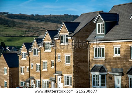 Modern affordable homes built from Peak District stone in Buxton, England. - stock photo
