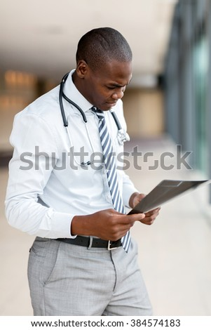 modern african american doctor looking at x-ray in office - stock photo