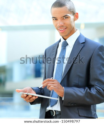 modern african businessman with tablet computer in office - stock photo