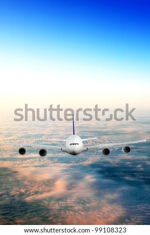 Modern airplane  over the clouds. - stock photo