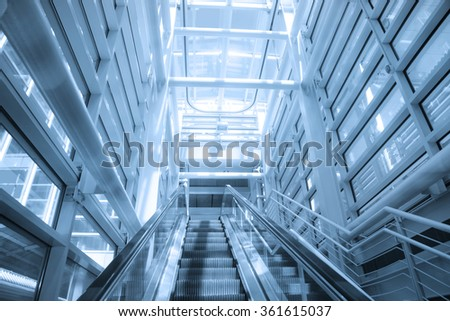 Modern airport architecture and escalator - stock photo