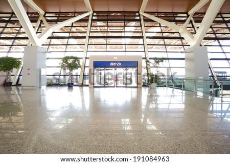 Modern airport interior glass wall aisle window and door - stock photo