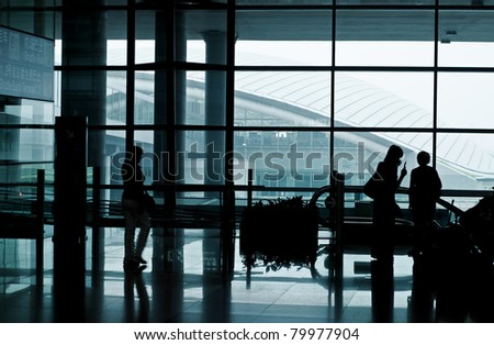 Modern airport interior with people. - stock photo