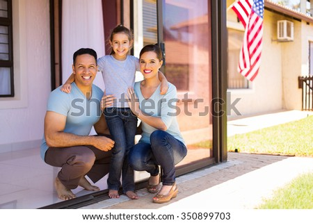 modern american family with USA flag on background - stock photo