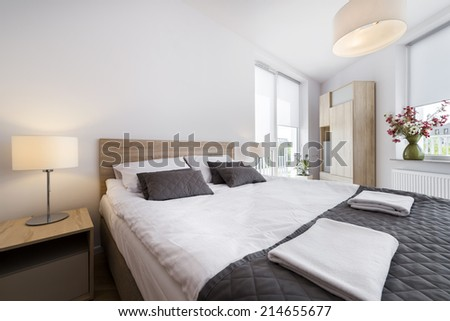 Modern and comfortable bedroom interior design in scandinavian style - stock photo