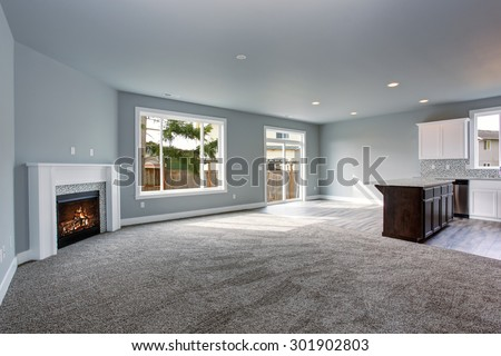 Modern and completely gray unfurnished interior of luxury town house. - stock photo