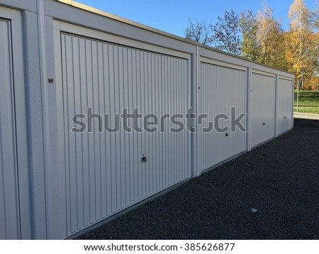 modern and neat white garages - stock photo