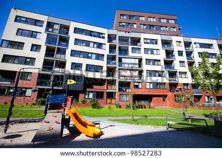 Modern and new apartment building. Multistoried, modern, new and stylish living block of flats. Real estate. New house. Newly built block of flats - stock photo