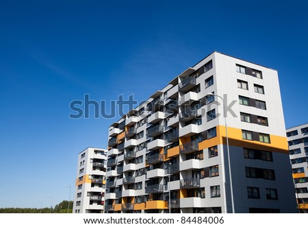 Modern and new apartment building. Multistoried modern, new and stylish living block of flats. Real estate. New house.Newly built block of flats - stock photo