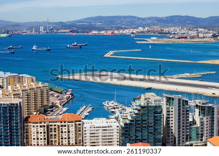 Modern apartment buildings in Gibraltar, bay, airport runway, Spain on the horizon. - stock photo