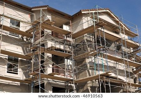 Modern Apartment Complex Under Construction - stock photo