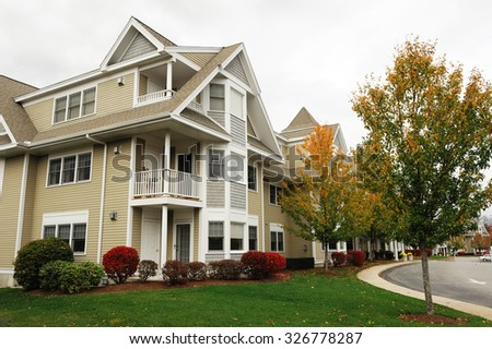 modern apartment townhouse and autumn trees - stock photo