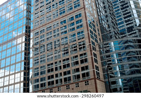 modern architecture abstract of glass skyscraper and window reflections in minneapolis minnesota - stock photo
