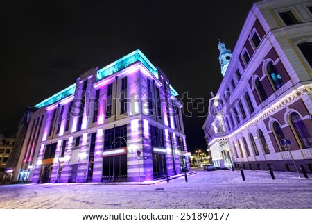 Modern architecture and Town hall in Old Riga, Latvia at winter night - stock photo