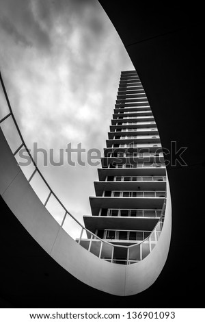 Modern architecture apartment with cloudy sky - stock photo