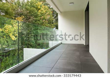 Modern architecture, balcony of a new apartment - stock photo