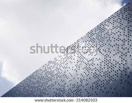 Modern architecture details Steel facade Dot pattern abstract - stock photo