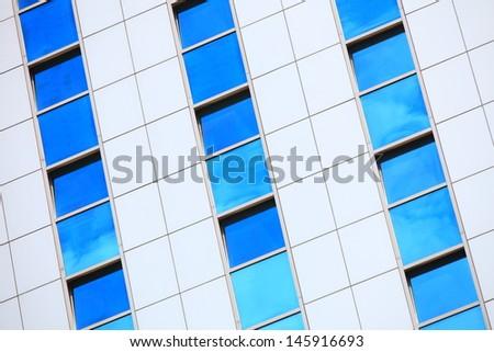 Modern architecture. Futuristic business corporate glass building, city background - stock photo