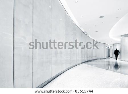 Modern architecture interior corridor and men. - stock photo