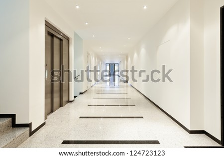 modern architecture, interior, view of the long corridor - stock photo
