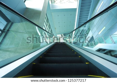 modern architecture steps of moving business escalator and stairs - stock photo