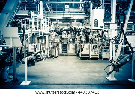 Modern assembly line without workers. In blue. - stock photo