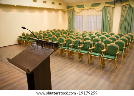 Modern auditorium hall for presentation with tribune - stock photo