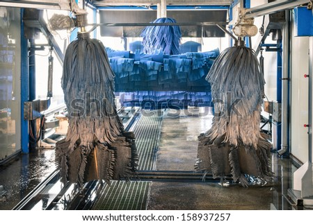 Modern automatic Carwash with blue Brushes - stock photo
