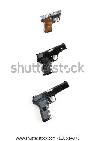Modern automatic hand gun pistols isolated on white background - stock photo