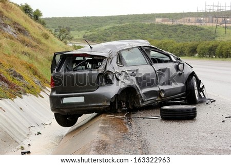 Modern automobile stuck on the road after rolling in the wet weather - stock photo