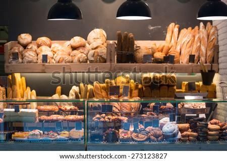 Modern bakery with different kinds of bread, cakes and buns   - stock photo