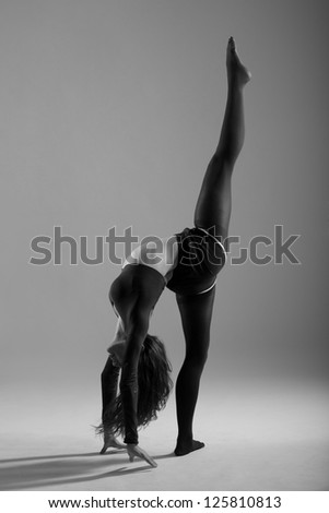 modern ballet dancer dancing on the white studio background - stock photo