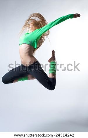 modern ballet dancer posing on white background - stock photo