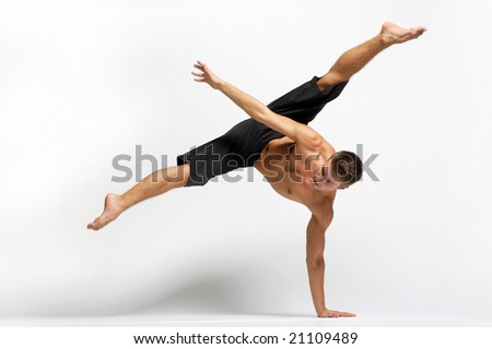 modern ballet dancer posing over white background - stock photo