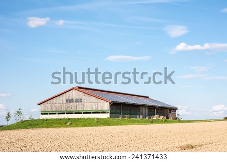 Modern barn with photovoltaic installation on the roof. - stock photo