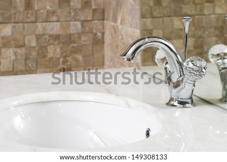 Modern bathroom chrome faucet - stock photo