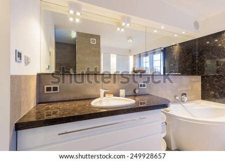 Modern bathroom in luxury apartment in Krakow city, Poland - stock photo