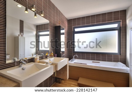 modern bathroom in luxury villa - stock photo