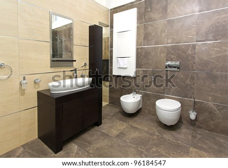 Modern bathroom interior with marble tiles and contemporary fixtures - stock photo