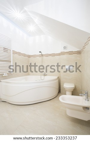 Modern bathroom with big corner bathtube - stock photo