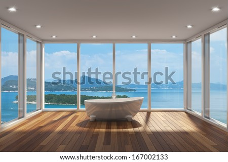 Modern bathroom with large bay window and view of sea - stock photo