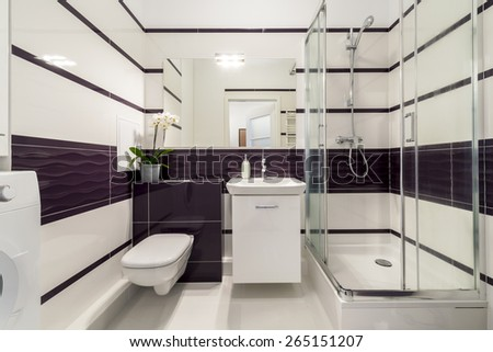 Modern bathroom with  shower cubicle in white and violet color - stock photo