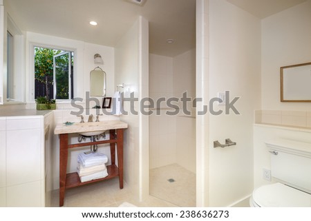 Modern bathroom with towels and window. - stock photo