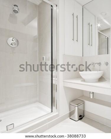modern bathroom with white ceramic appliances and shower cabin - stock photo