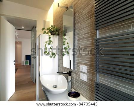 modern bathroom with white washbasin and radiator and wood floor - stock photo