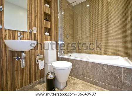 modern bathroom with wood imitation wall and marble foor tiles - stock photo