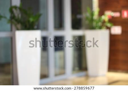 Modern beauty glass door  blur background with bokeh - stock photo