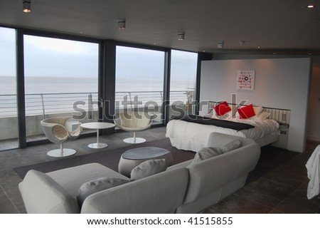 Modern bed room overlooking the sea - stock photo