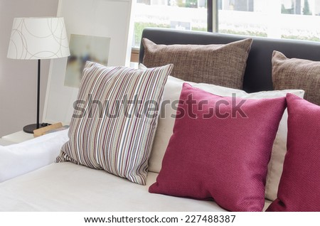 modern bedroom design with red pillows at home - stock photo